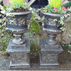 Pair of Heavy Black & Gold Painted Garden Urns On Pedestals