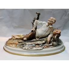 Capodimonte Reclining Tramp Sculpture