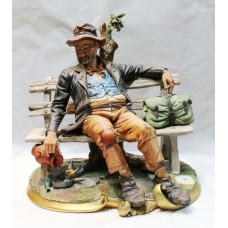Capodimonte Tramp on Bench Figurine by Volta