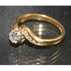 Diamond Single Stone Crossover Twist Yellow Gold Ring