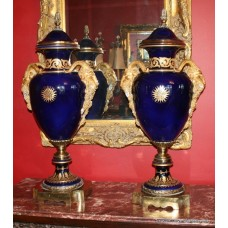 Pair of Sevres Style Cobalt Blue Rams Head Lidded Urns