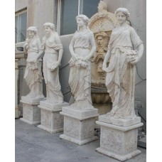 Set of Four Carved Stone Golden Travertine Classical Style Statues